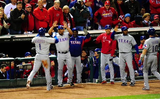 Rangers shortstop Elvis Andrus celebrates with teammates after scoring the winning run in Texas 2-1 win over St. Louis in Game 2.