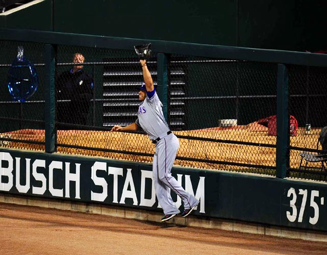 Rangers outfielder Nelson Cruz grabs a deep fly ball hit by Albert Pujols at the warning track in the eighth inning.