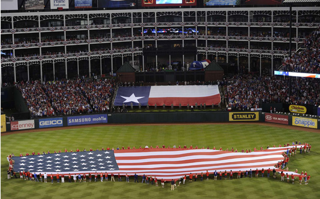 Pregame ceremonies included the display of a giant United States-shaped American flag that covered much of the outfield at the Ballpark.