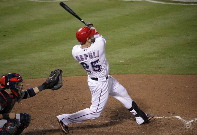 Mike Napoli gave Derek Holland and the Rangers some breathing room in the sixth with a three-run homer to left off Cardinals reliever Mitchell Boggs.