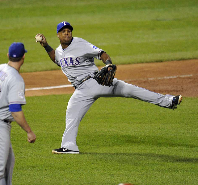 Rangers' third baseman Adrian Beltre barehands a slow roller and throws out the runner.