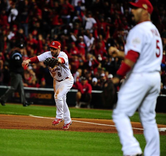 Colby Lewis bunted into a unusual double play as Cardinals third baseman David Freese fielded the ball and threw to shortstop Rafael Furcal, who was covering third. Furcal then relayed to second baseman Nick Punto, who was covering first.