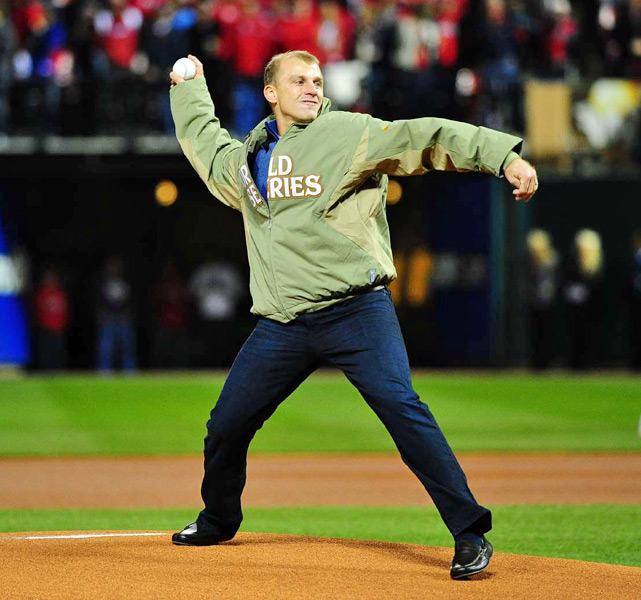Former Cardinals shortstop and World Series MVP David Eckstein throws out the ceremonial first pitch.