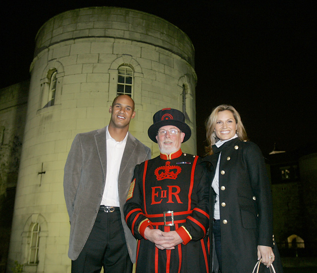 Taylor poses with his wife Katina and a Yeoman Warder outside of The Tower of London.