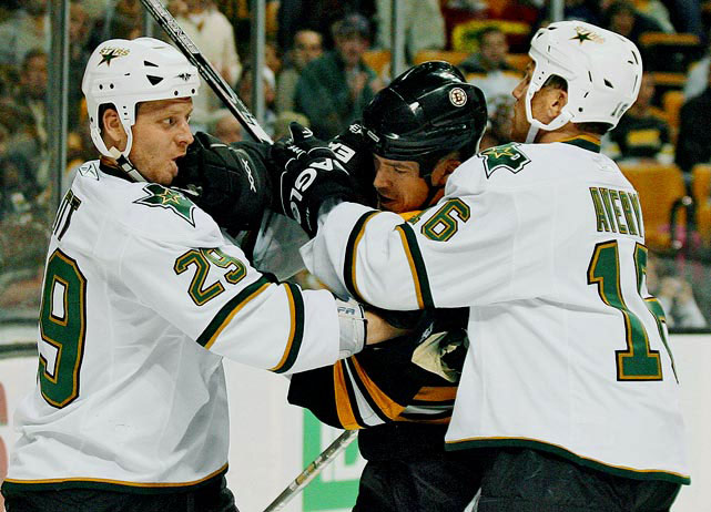 "As the Stars sink in the West, Avery and co-agitator Steve Ott run wild in an ugly 5-1 loss in Boston on Nov. 1, 2008, drawing 69 of the 146 penalty minutes handed out to both teams, and three of the seven misconducts. In the third period, Bruins center Marc Savard says to Mike Modano in the face-off circle, ""Too bad you'll be retiring after having to play with those clowns."" Modano replies, ""I know"" and later tells reporters that the debacle was ""idiotic and stupid ... one of the most embarrassing things I've seen."" As for Avery, who also fought with Boston's Andrew Ference and screamed obscenities at a heckler and his female companion, he tells SI: ""It's a great group of guys, for sure, but they're still trying to figure me out. The [Stars] don't seem to want the full deal with me. That takes a lot from my intensity.... Games [like the one in Boston] are the ones where I'm most effective, where I get my blood going."" A report is filed with the NHL, but Avery avoids suspension."