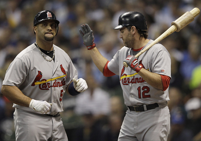 Berkman congratulates Pujols after an NL championship home run against the Milwaukee Brewers. Pujols is a three-time NL MVP and won a World Series with the Cardinals in 2006. The nine-time All-Star, who has played his entire career in St. Louis, is in the final year of his contract.