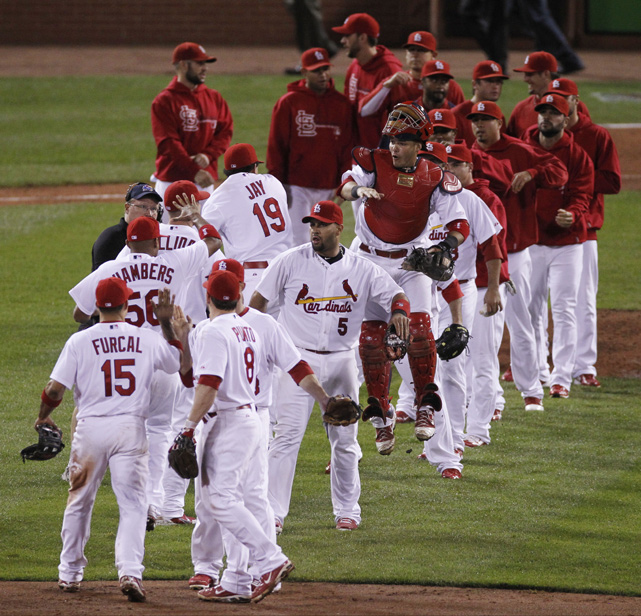 The 'Cards celebrate after winning Game 3 of the NLCS against the Milwaukee Brewers to go up 2-1 in the series. St. Louis would go on to win the series in six games and clinch its 18th NL pennant.