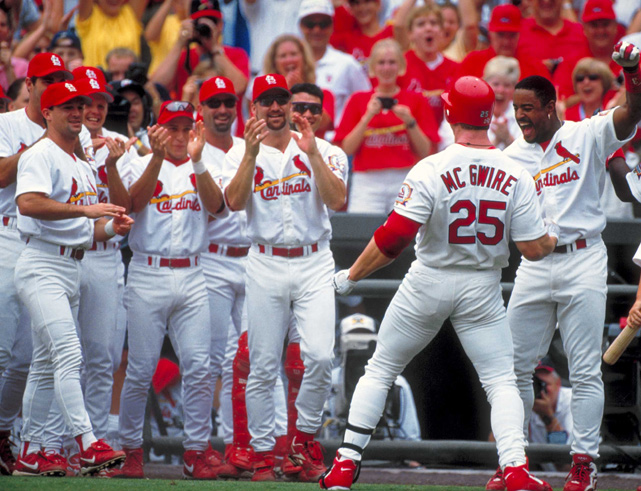 McGwire celebrates with his teammates after hitting his 61st home run to tie Roger Maris for the single-season record. McGwire would hit 70 home runs in 1998, a record that stood until Barry Bonds blasted 73 in 2001.