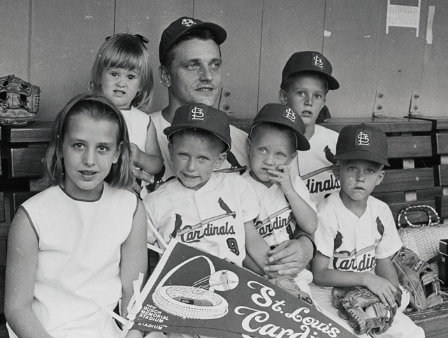 Maris sits with his six children before a father-son game at Busch Memorial Stadium in St. Louis. Maris played his final two seasons with the Cardinals and was part of their 1967 team that won the World Series.