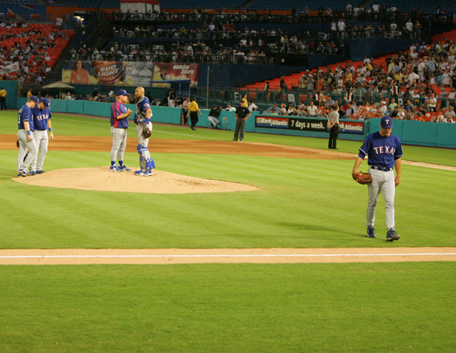 Rogers walks off the mound at Pro Player Stadium in Florida during his final season with the Rangers. Rogers pitched for Texas from 1989 to 1995 and pitched a perfect game on July 28, 1994, against the Angels.