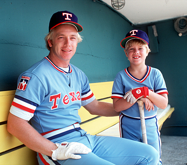 Third baseman Buddy Bell poses with his son David in the Rangers' dugout. Bell, a member of the Texas Ranger Hall of Fame, was a five-time All-Star and six-time Gold Glove winner.