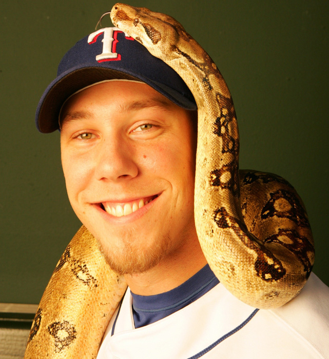 Nelson poses in the Rangers' dugout with his pet snake Angel. Although Loe, now with the Milwaukee Brewers, stands at 6-9, his 7-foot boa constrictor is even taller.