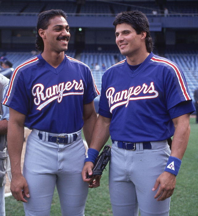 Gonzalez (left) and Canseco chat before a contest against the New York Yankees in 1992. Gonzalez won two AL MVP Awards -- one in 1996 and one in 1998 -- with the Texas Rangers.