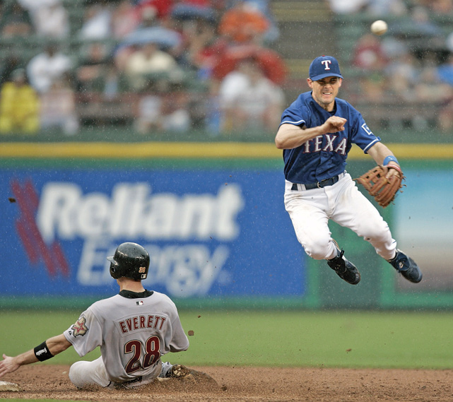 Young turns a double play against the Houston Astros in 2004. The infielder has played his entire career in Texas. He is a seven-time All-Star and winner of the 2005 AL batting title.