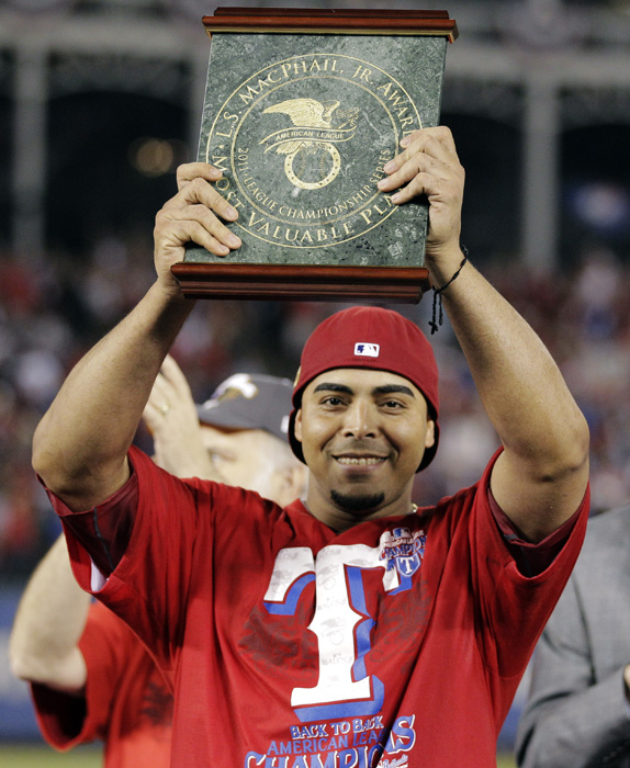 Cruz holds up the ALCS MVP award he earned after helping the Rangers defeat the Tigers in six games. The Rangers have won back-to-back AL pennants, earning them their only two World Series appearances in franchise history.