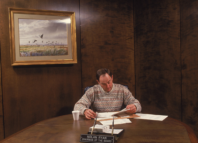 Current Rangers president Nolan Ryan looks over some papers during an SI photo shoot. The Hall of Fame pitcher and eight-time All-Star threw a major-league record seven no-hitters in his career, but never won a Cy Young.