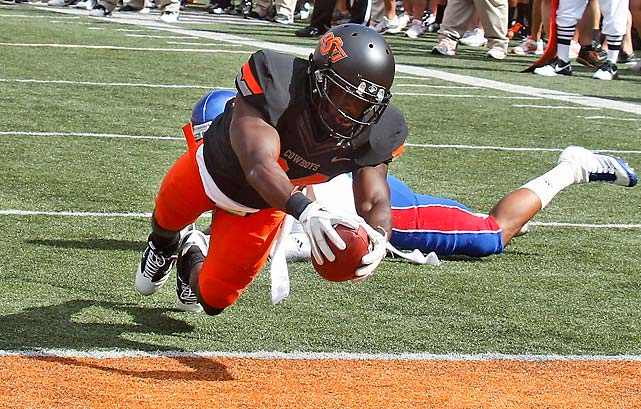 This one was over in a hurry. Brandon Weeden threw for 288 yards and five touchdowns before being pulled in the first half and had the most accurate day ever for an Oklahoma State passer, completing 24-of-28 passes. Justin Blackmon caught two touchdown passes, as did Hubert Anyiam (pictured).