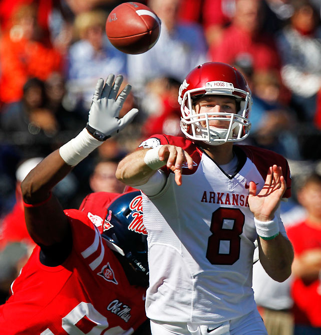 For one half, it looked like Houston Nutt was going to exact revenge against his former team. But the Razorbacks came to life in the third quarter, rising from a 17-0 deficit to take control. The Rebels kept it close, but Tyler Wilson's (pictured) two second-half rushing touchdowns saved the day.