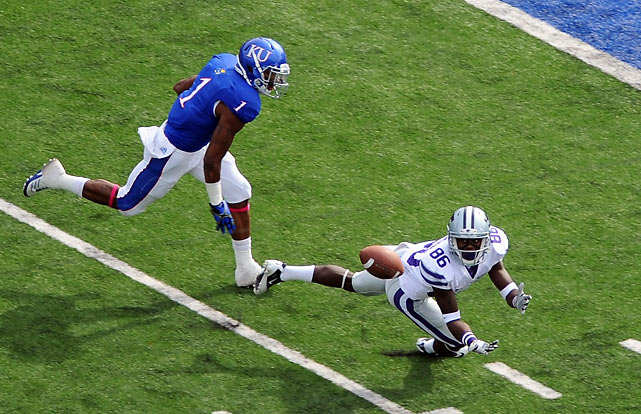 Tramaine Thompson (pictured) helped out quarterback Collin Klein with this beautiful diving catch early. Klein didn't need much help after that. The Wildcats' signal-caller passed for 195 yards and a touchdown and rushed for 92 yards and four more scores to help K-State improve to 7-0.