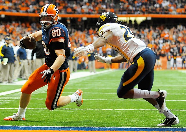 West Virginia arrived in Syracuse intent on avenging last year's shocking loss to the Orange. Instead, the Mountaineers suffered an even more unthinkable defeat. WVU quarterback Geno Smith threw two costly interceptions, and the Syracuse offense rolled behind a three-touchdown night from tight end Nick Provo (pictured). West Virginia was the highest-ranked opponent Syracuse had beaten since a 50-42 triple-overtime over No. 8 Virginia Tech in 2002.