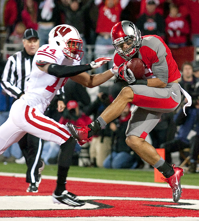 Wisconsin had its heart broken again. Braxton Miller threw a 40-yard touchdown pass to Devin Smith (shown) with 20 seconds left as Ohio State stunned Wisconsin. It was almost exactly seven days earlier that the Badgers were beaten 37-31 at Michigan State on a miracle pass on the final play of the game. The latest heartbreak, just like that one, wasn't confirmed until it passed a video review.