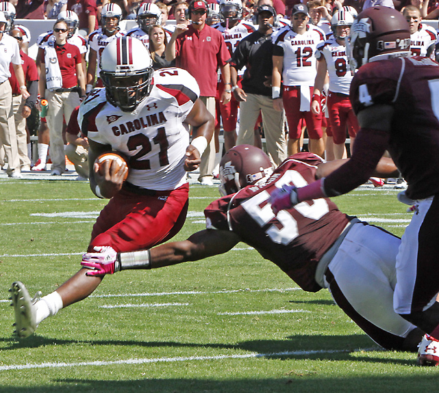 Marcus Lattimore (left) scored on this run, but it was one of his few highlights as he finished with 39 yards before leaving with a knee injury.