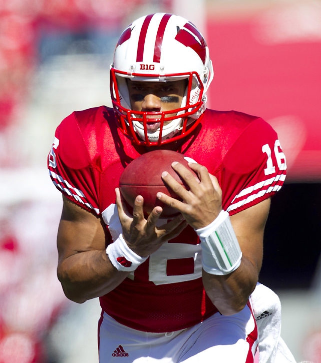 Quarterback Russell Wilson added a touchdown reception to his impressive running and passing resume for the season when he caught a 25-yard touchdown pass from running back Montee Ball. Ball rushed for 142 yards and three touchdowns in addition to his touchdown pass as Wisconsin improved to 6-0.