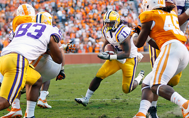 LSU (7-0, 4-0 Southeastern Conference) continued its early march, winning its seventh straight game by double digits. Jarrett Lee threw for two touchdowns, while Spencer Ware (pictured) caught one and ran for another. Matt Simms was 6 of 20 for 128 yards and two interceptions in his first start for Tennessee (3-3, 0-3).