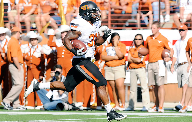 Jeremy Smith (pictured) paced Oklahoma State (6-0, 3-0 Big 12) with touchdown runs of 30 and 74 yards, totaling 140 yards on the ground. Justin Gilbert tied a school record with his fourth kickoff return for a touchdown. Texas (4-2, 1-2) started freshman David Ash for the first time, and he played every snap. Case McCoy and Ash had been splitting time the previous three games.