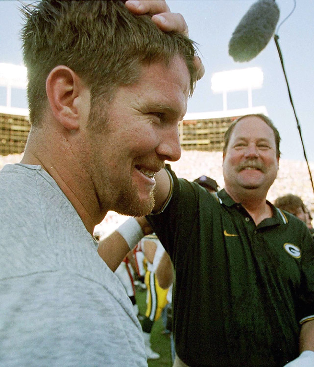 "For seven years, Mike Holmgren coached Brett Favre and the Packers never missed the playoffs. Green Bay won the Super Bowl in 1996 with Favre at QB and Holmgren on the sidelines, but came up short in the title game during their repeat effort in '97. Holmgren is often acknowledged as taming the quarterback known as the ""Gunslinger"" and helping mold him into one of the greatest to ever play the game."
