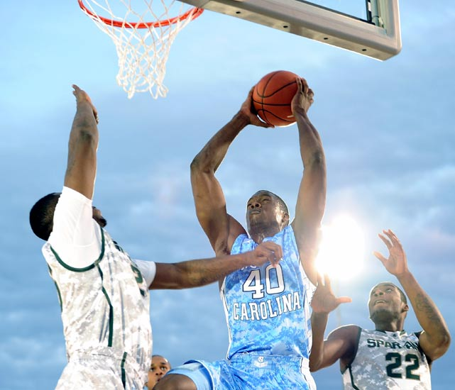 North Carolina's Harrison Barnes raises up for a bucket against Michigan State's big men. The blue-chipper led all scorers with 17.
