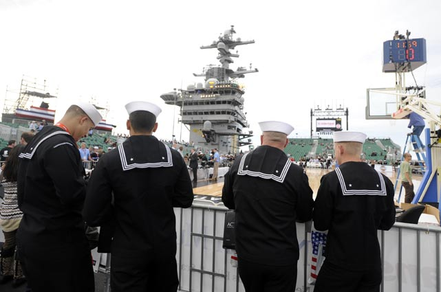Sailors stand courtside before Friday night's game at the USS Carl Vinson, which had a basketball court and stands specially constructed for the event.