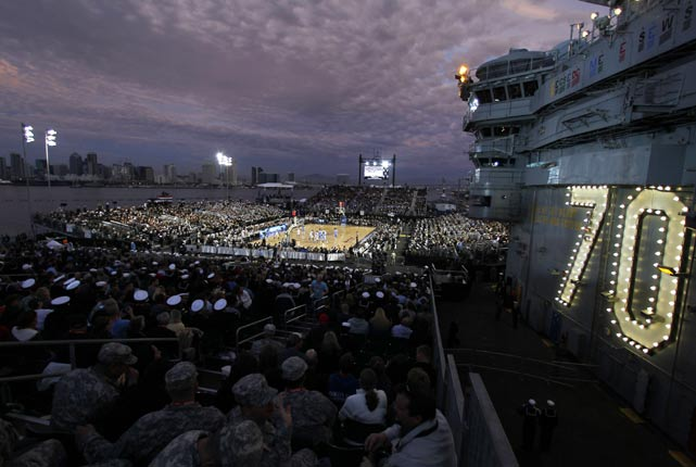 With the sun going down, a look from above at the USS Carl Vinson under the lights.