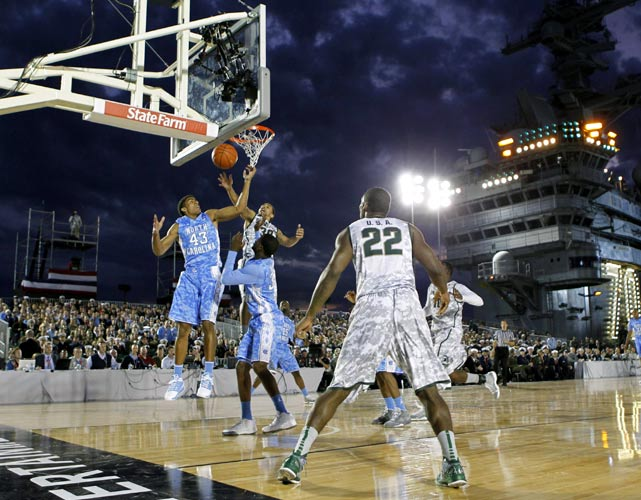 North Carolina's James McAdoo deflects a shot by Michigan State's Brandon Wood in the second half. McAdoo had four points and four rebounds off the bench.