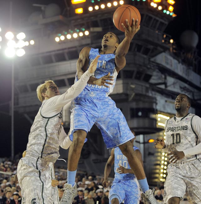 North Carolina guard Dexter Strickland drives to the hoop against the Spartans' defense. Strickland helped orchestrate UNC's offense, which shot 48 percent from the field. He finished with 10 points and five assists.