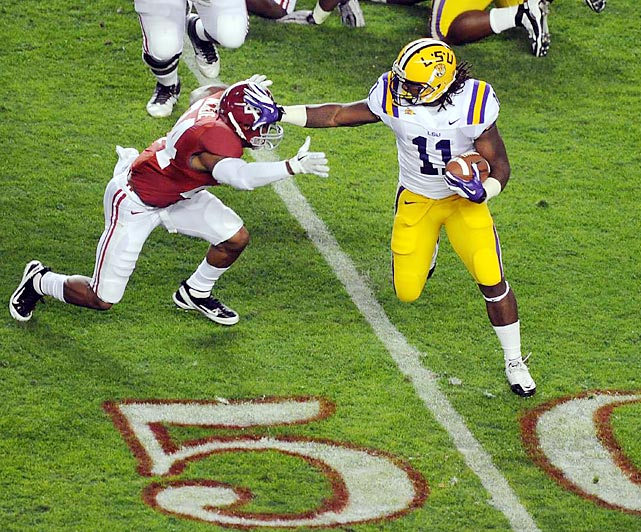 LSU running back Spencer Ware stiff arms an Alabama defender during the No. 1 Tigers' 9-6 victory over the No. 2 Tide.
