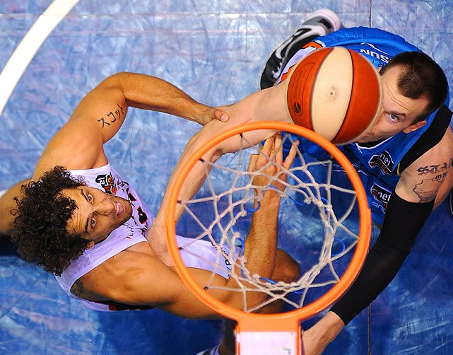 Matthew Knight of the Perth Wildcats and Will Hudson of the Gold Coast Blaze battle for a rebound during a game in Australia.