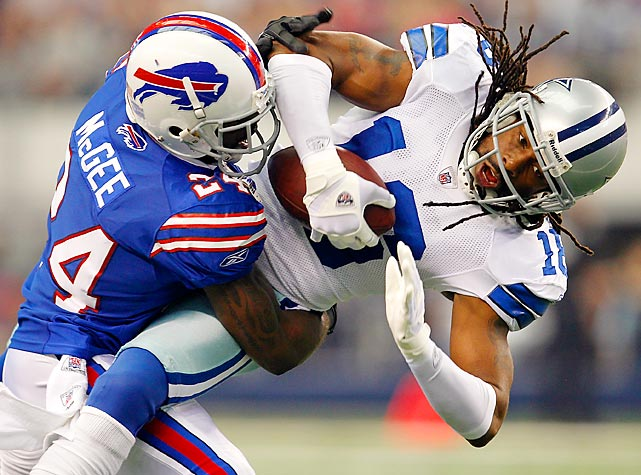 Bills' corner Terrence McGee tackles Dallas receiver Jesse Holley after he pulls in a pass. The Cowboys dominated Buffalo 44-7.