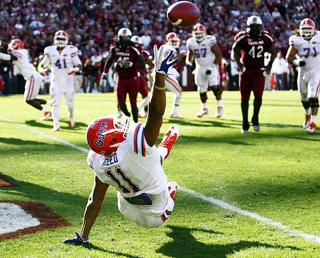 Gators' tight end Jordan Reed tries in vain to score during a 17-12 loss to South Carolina.