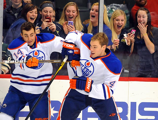 Edmonton's Jordan Eberle (left) and Taylor Hall seem to be quite a hit with the ladies in St. Paul, Minn., before a game against the Wild. Impressively, this was before the Oilers won 5-2.