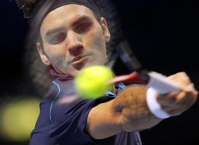 Roger Federer hits a forehand shot against David Ferrer in the semifinals of the ATP World Tour finals, which Federer won 6-3, 6-7 (6), 6-3 on Sunday.