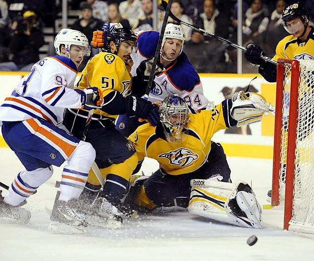 Edmonton center Ryan Nugent-Hopkins (left) can't capitalize on a scoring chance against the Nashville Predators. The rookie did, however, finish with two assists in the Oilers' 6-2 win.