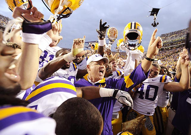 Les Miles (center) celebrates with his top-ranked LSU Tigers after defeating Arkansas 41-17 to finish the regular season undefeated.