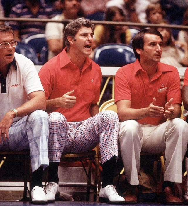 Bob Knight and Krzyzewski sit on the bench during the 1979 Pan American games in San Juan, Puerto Rico. Krzyzewski played for Knight at Army and coached under him at Army and Indiana.