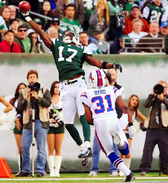 New York Jets receiver Plaxico Burress beats Jairus Byrd for a one-handed catch.