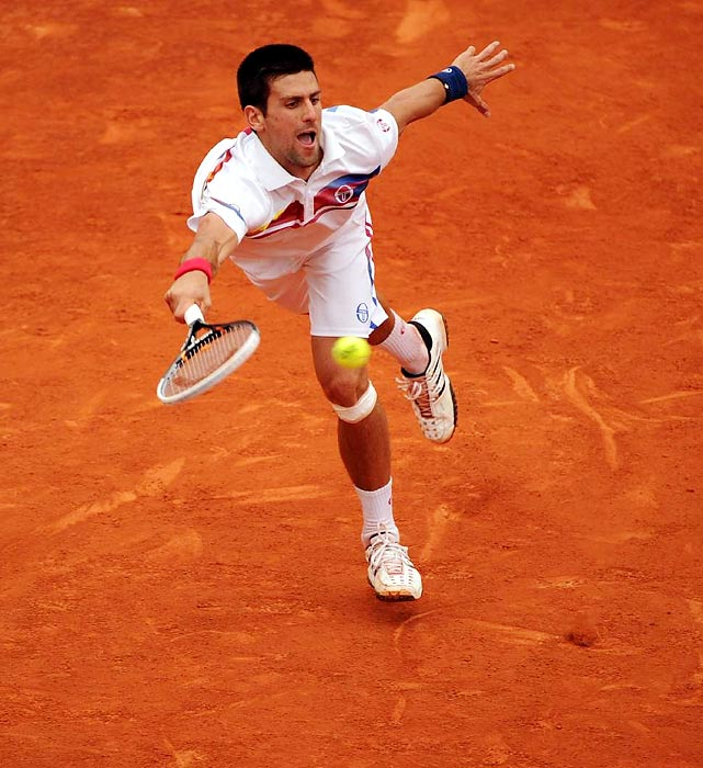 Novak Djokovic stretches for a ball at the 2011 French Open.