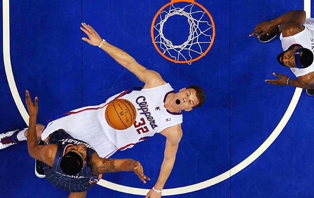 Blake Griffin gets a bottoms-up view of the hoop after being knocked down during a game against the Charlotte Bobcats.