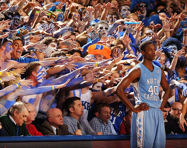 Harrison Barnes shows no emotion as the Cameron Crazies try to get his attention.