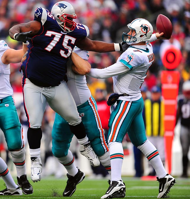 New England's Vince Wilfork puts the pressure on Miami quarterback Chad Henne.