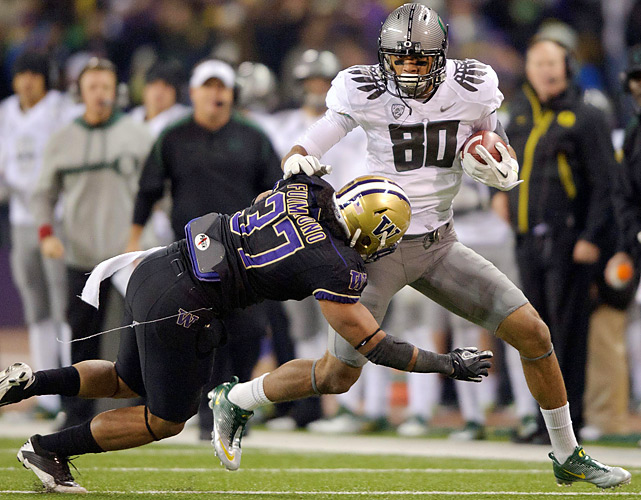 Oregon's LaMichael James returned from an elbow injury to tally 156 yards and a touchdown and help the No. 6 Ducks overwhelm Washington in the second half and defeat the Huskies 34-17 for the eighth straight time, the longest winning streak for either side of the border-state rivalry.